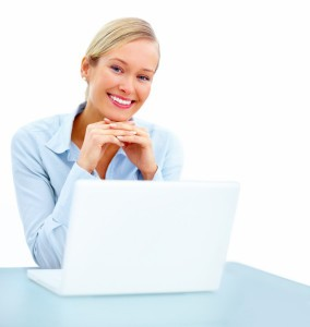 happy-young-woman-in-business-smiling-with-laptop